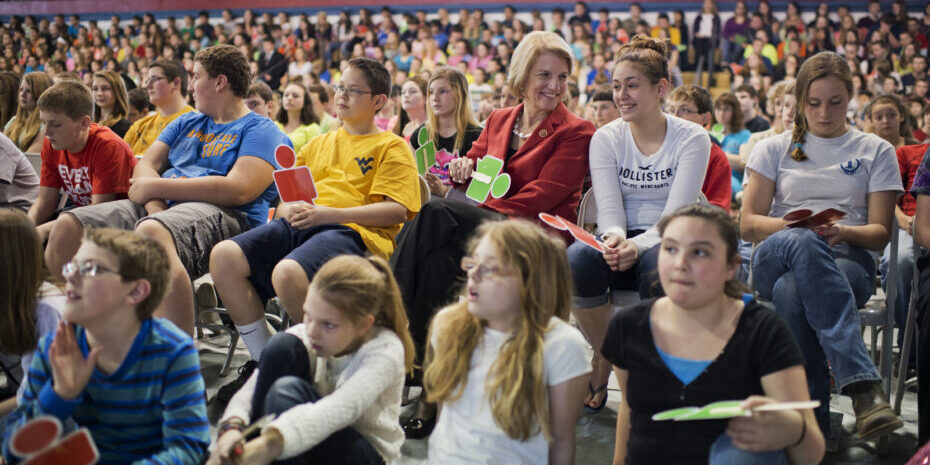 UNITED STATES - APRIL 15: Rep. Shelley Moore Capito, R-W.Va., who is running for the Senate in West Virginia, sits with students during an internet safety event sponsored by Google at Robert Bland Middle School in Weston, W.Va., April 15, 2014. (Photo By Tom Williams/CQ Roll Call) (CQ Roll Call via AP Images)